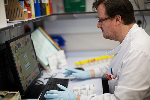 A man working in a pathology lab